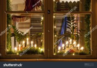 Electric Christmas Candles And Decorations Behind A Wooden ...