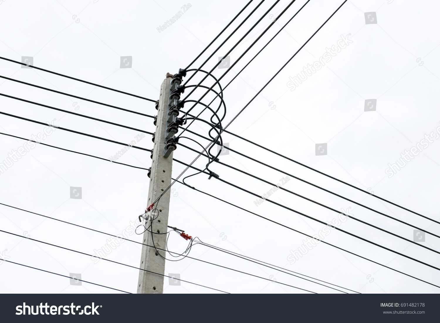 hight resolution of electric pole connect to the high voltage electric wires