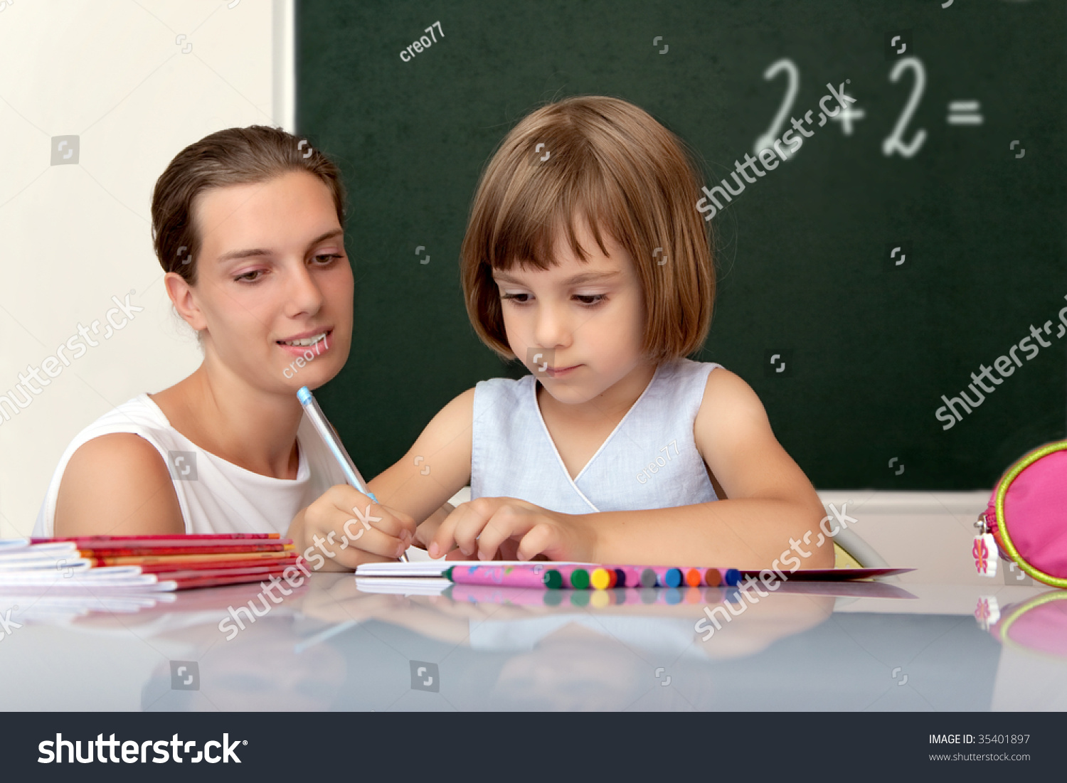 Elementary School Pupil Working Under The Supervision Of A Teacher Stock Photo 35401897 : Shutterstock