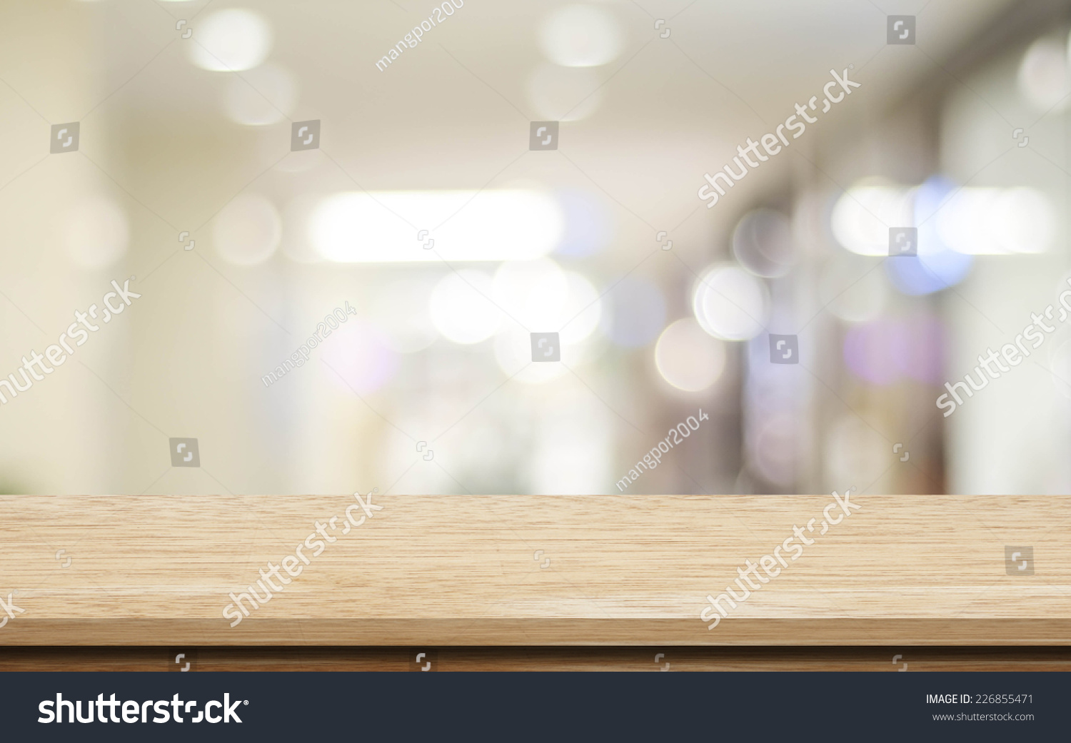 kitchen computer desk salt containers empty table and blurred store with bokeh background ...