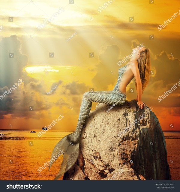 Fantasy. Beautiful Woman Mermaid With Fish Tail And Long Developing Hair Stock 207901984