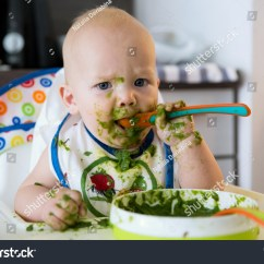 Baby High Chair For Eating Plastic Transparent Feeding Adorable Child Spoon Stock Photo