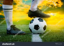 Soccer Player Kicking the Ball Foot