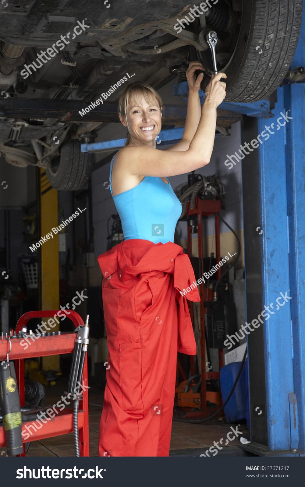 Female Mechanic Working On Car Stock Photo 37671247