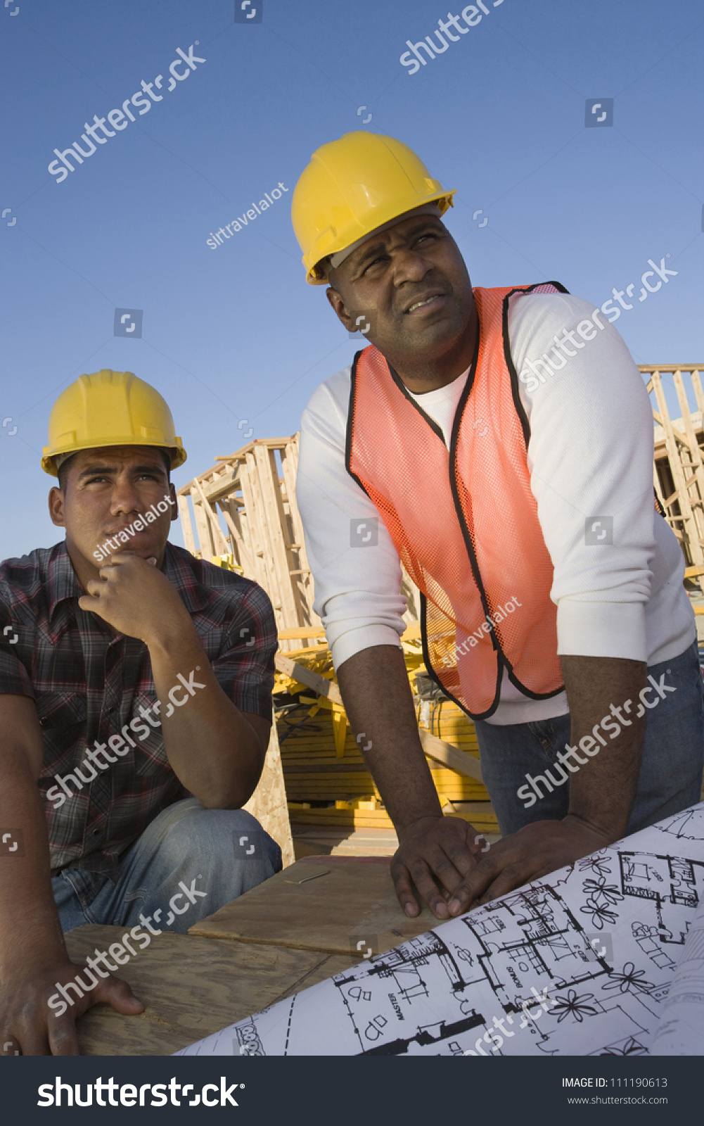 Foreman With Co-Worker Looking At Framework At Construction Site Stock Photo 111190613 : Shutterstock