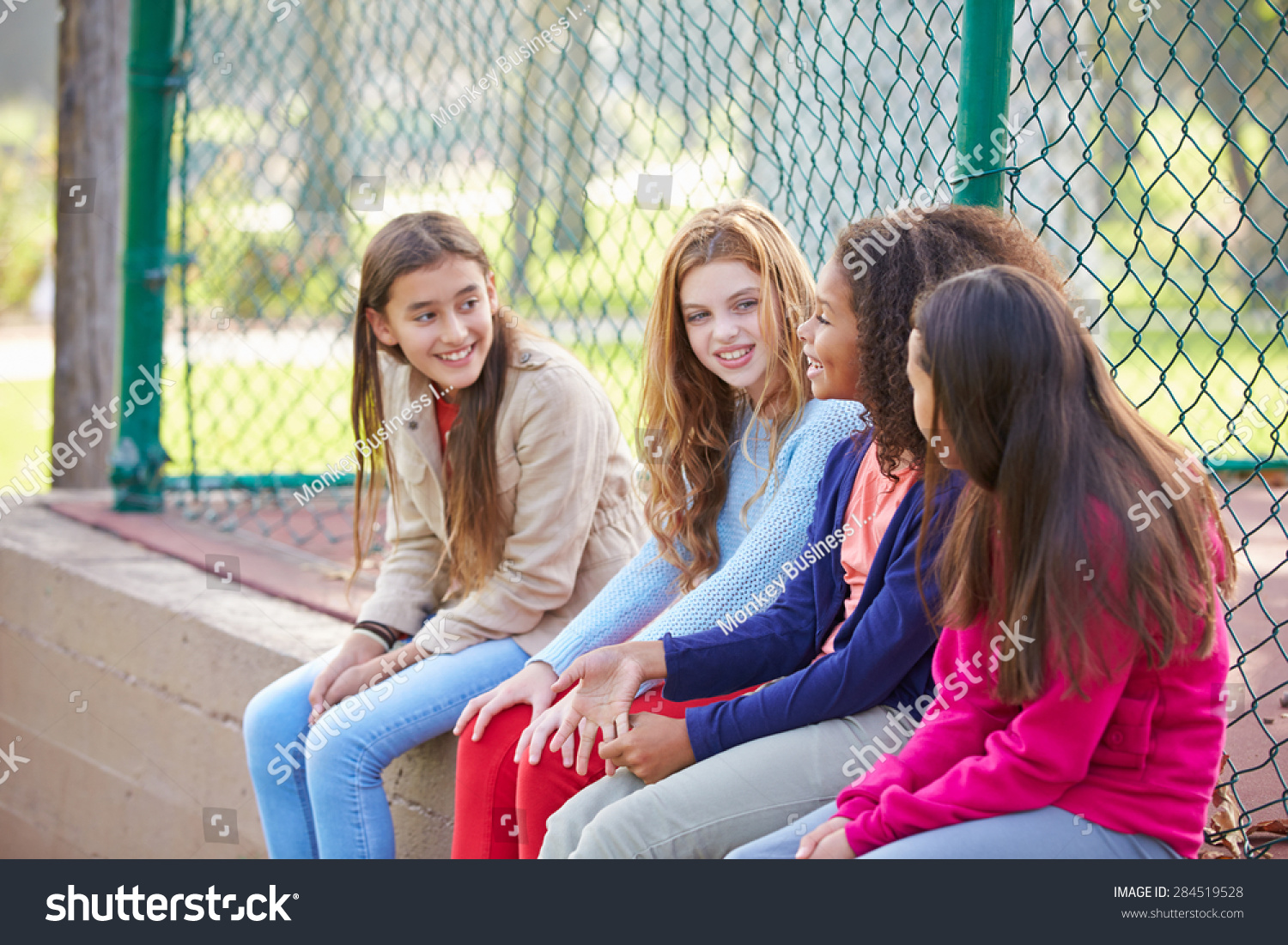 Four Young Girls Hanging Out Together In Park Stock Photo 284519528 : Shutterstock