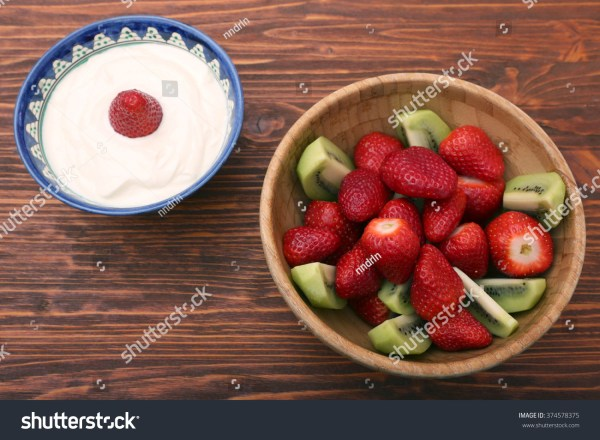 Fresh Strawberries In A Wooden Bowl Stock Photo 374578375