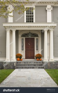 Front Door Of Home Showing Two Pillars With Arch And Twin