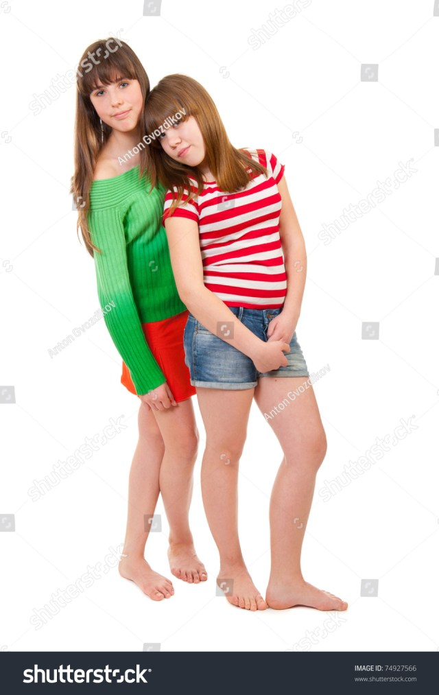 Full Length Portrait Of Two Girls Barefoot On A White Background