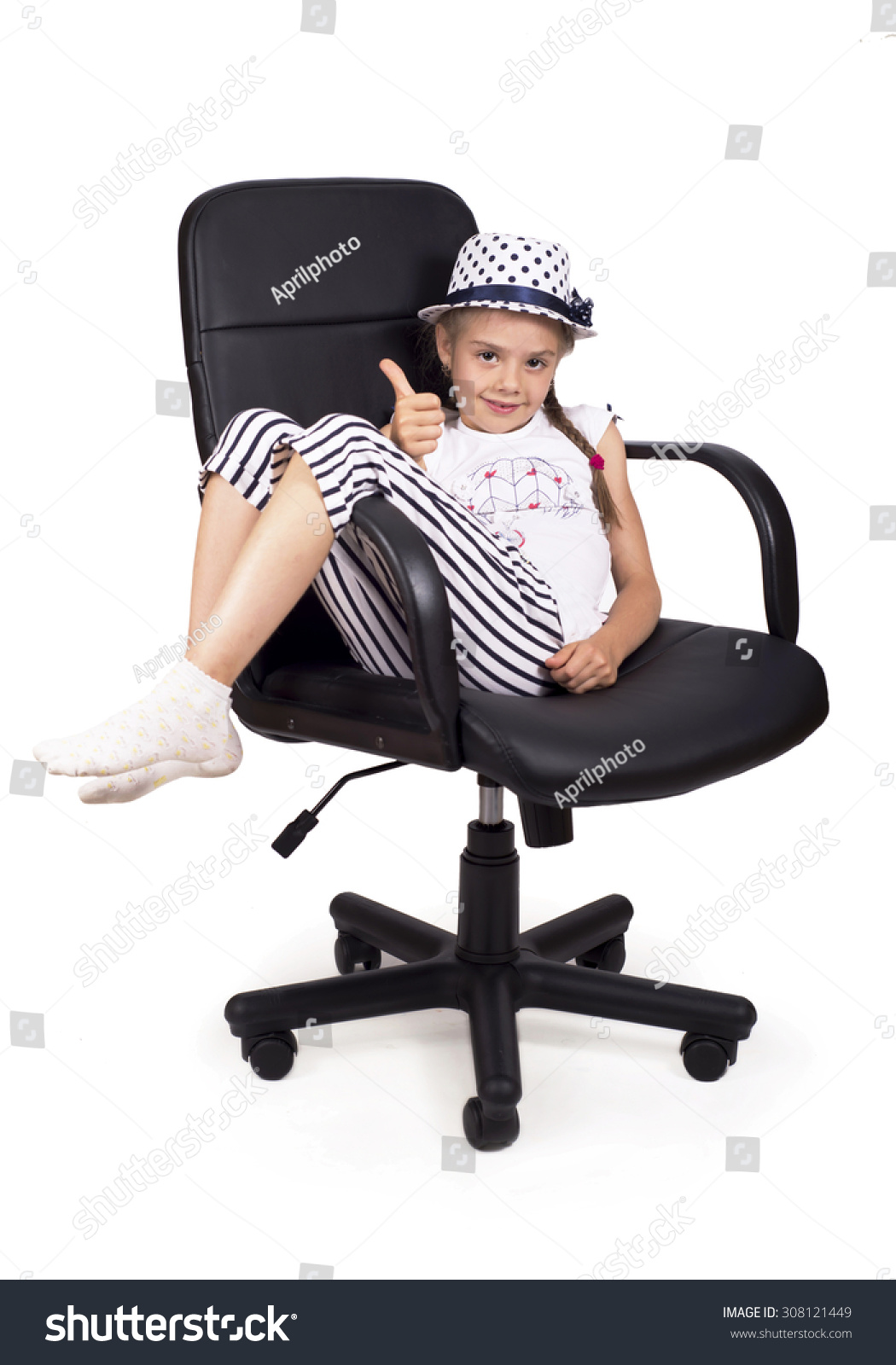 Girls Office Chair Girl In A Hat Raises Her Arms And Legs Up Sitting On A