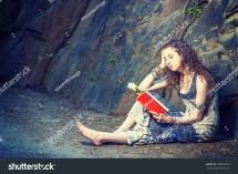 Girl Reading . Wearing Long Dress Barefoot