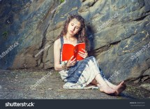 Girl Reading Wearing Long Dress Stock