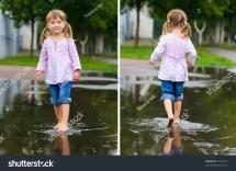 Girl Walk Barefoot In Puddle Splashing Water