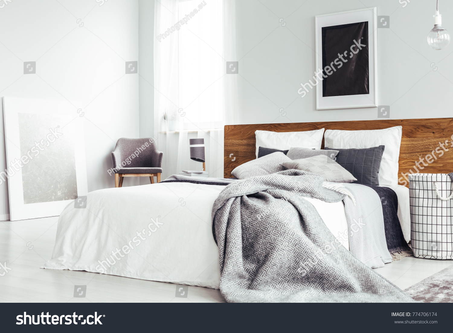 bedroom chair with blanket wedding covers for hire in kent grey on bed wooden bedhead stock photo edit now 774706174 simple interior dark poster and