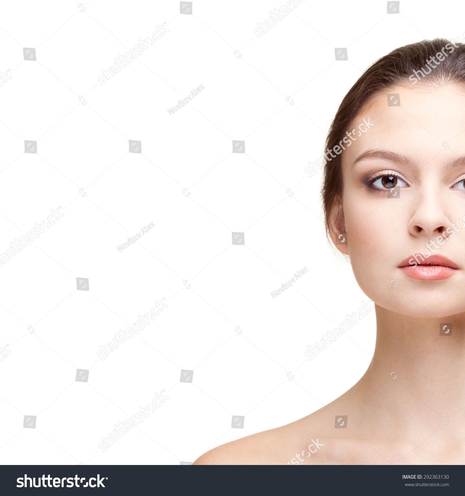 Half Face Portrait Of Beautiful Young Woman On The Blue