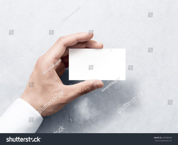 A Hand Holding Business Card Templates