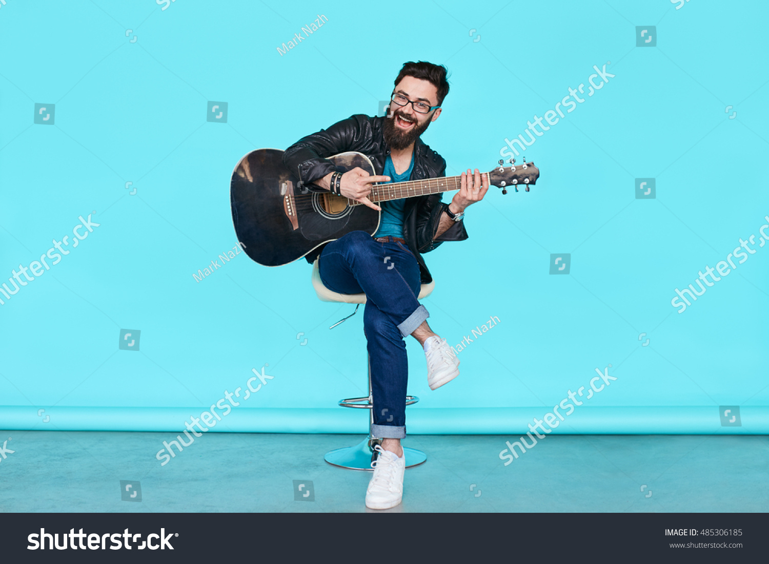 guitar playing chair overstock chairs and ottomans handsome bearded musician over stock photo