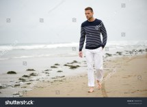 Man Walking Alone On Beach