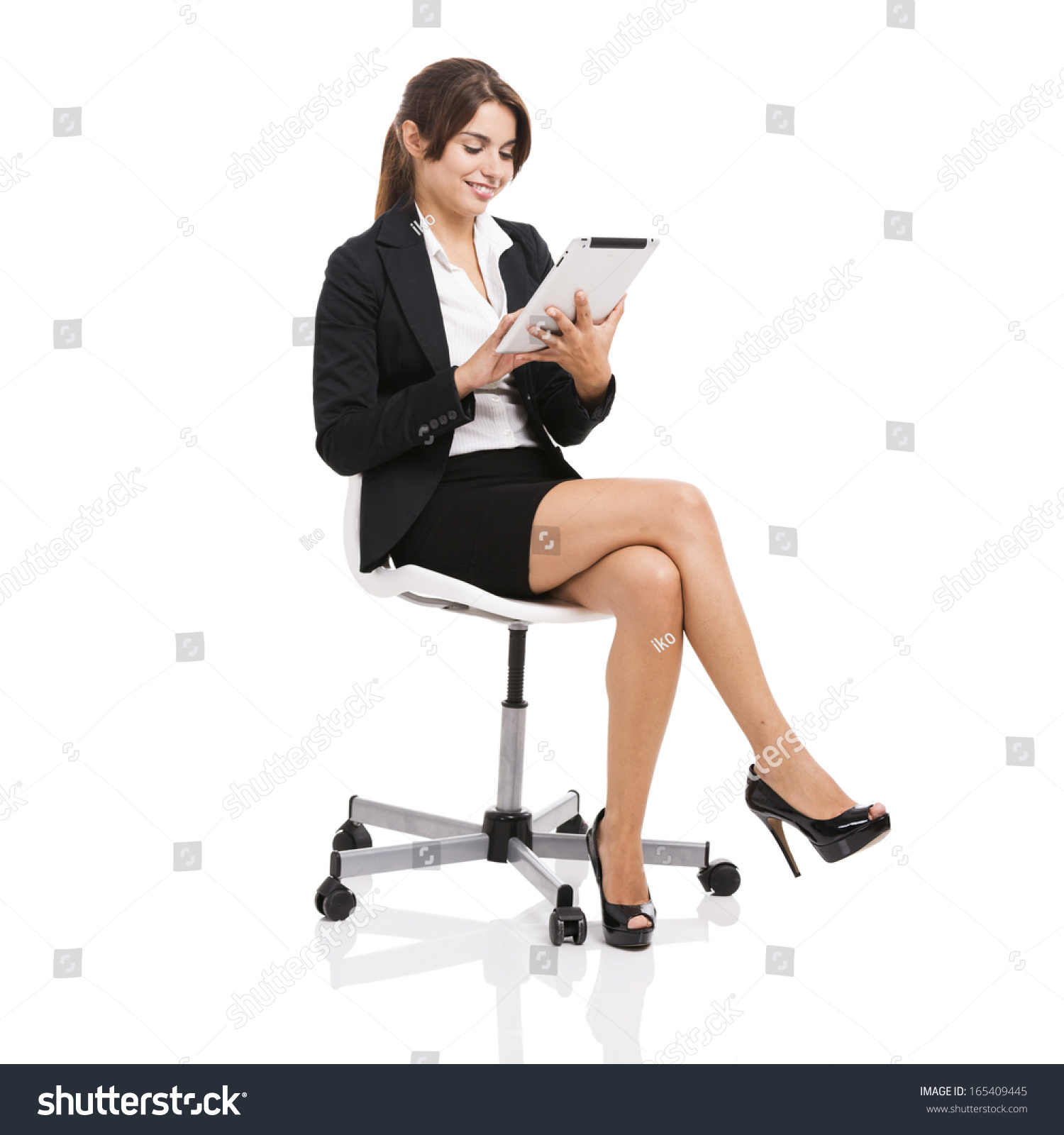 woman sitting in chair desk staples happy business on working with a