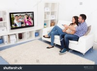 Happy Young Couple Livingroom Sitting On Stock Photo ...