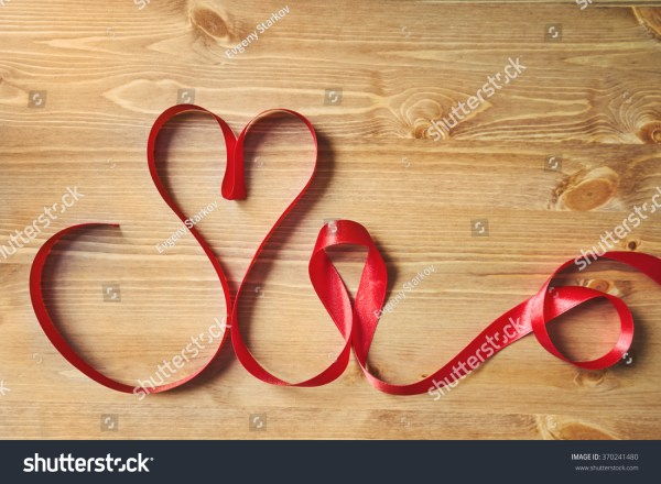 Heartshaped Red Ribbon Wooden Table Stock