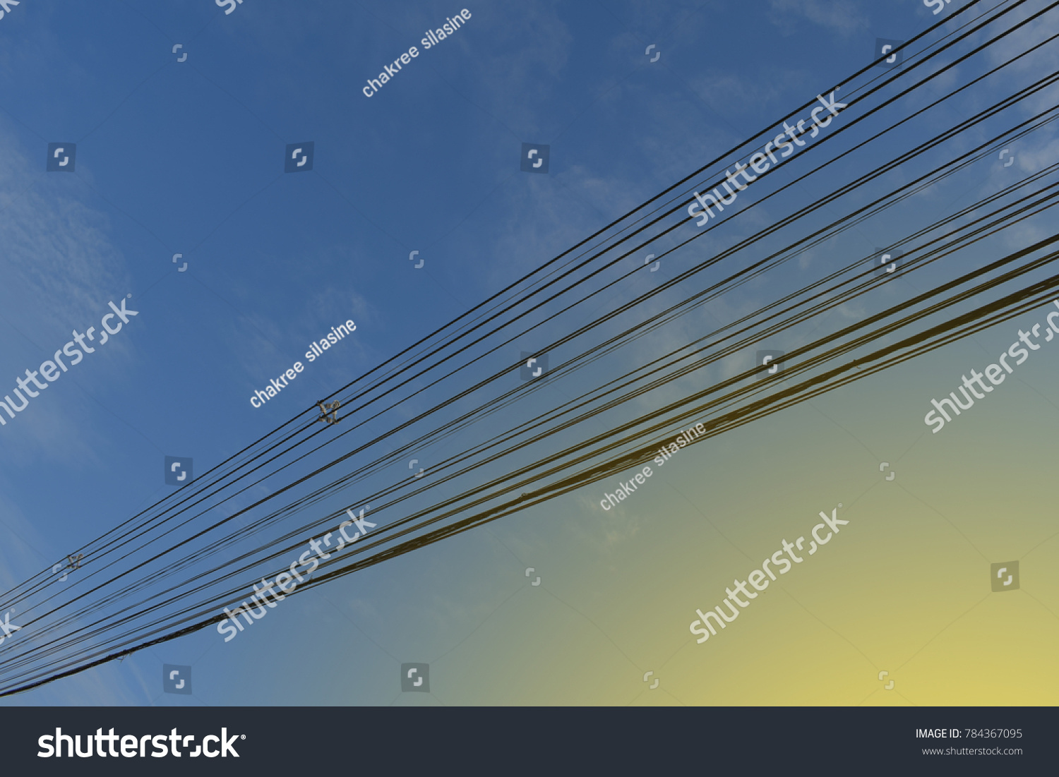 hight resolution of high voltage cables and phone lines head down through the blue sky to send electricity