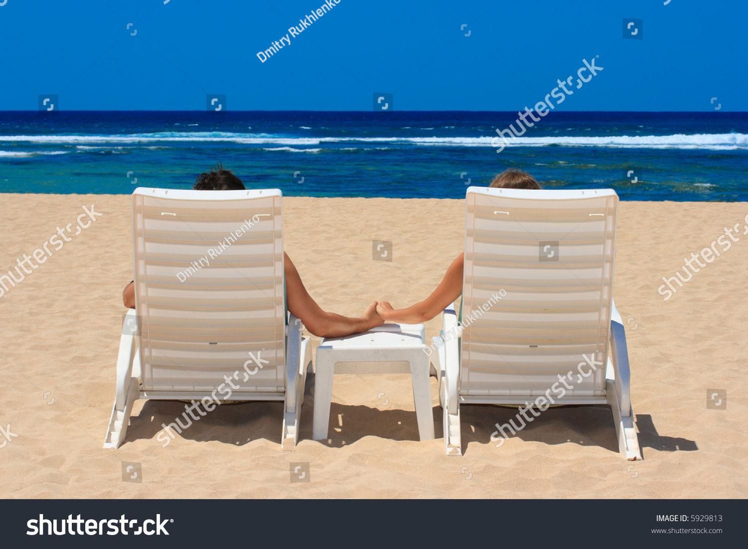 Sunbathing Chairs Honeymoon Couple In Beach Chairs On Resort Sunbathing