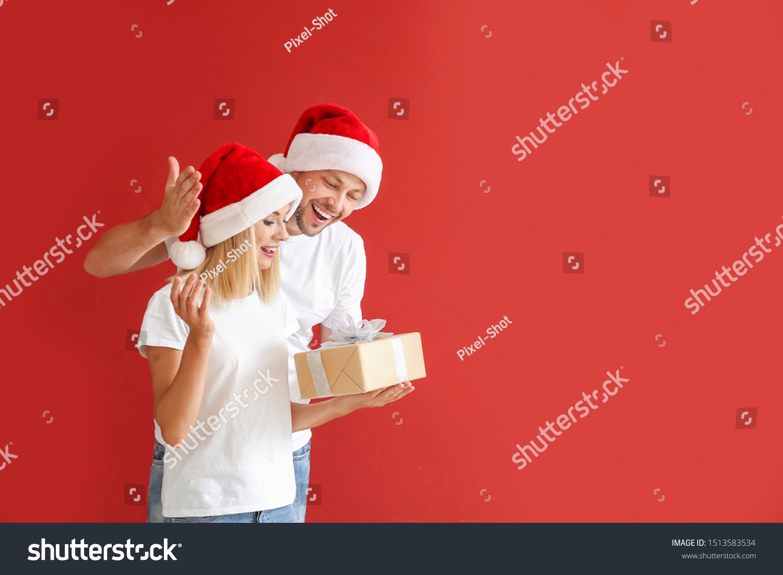 Husband Giving Christmas Present His Wife Stock Photo Edit Now 1513583534