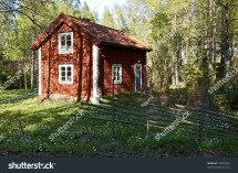 Idyllic Swedish House In Forest With Fence. Typical