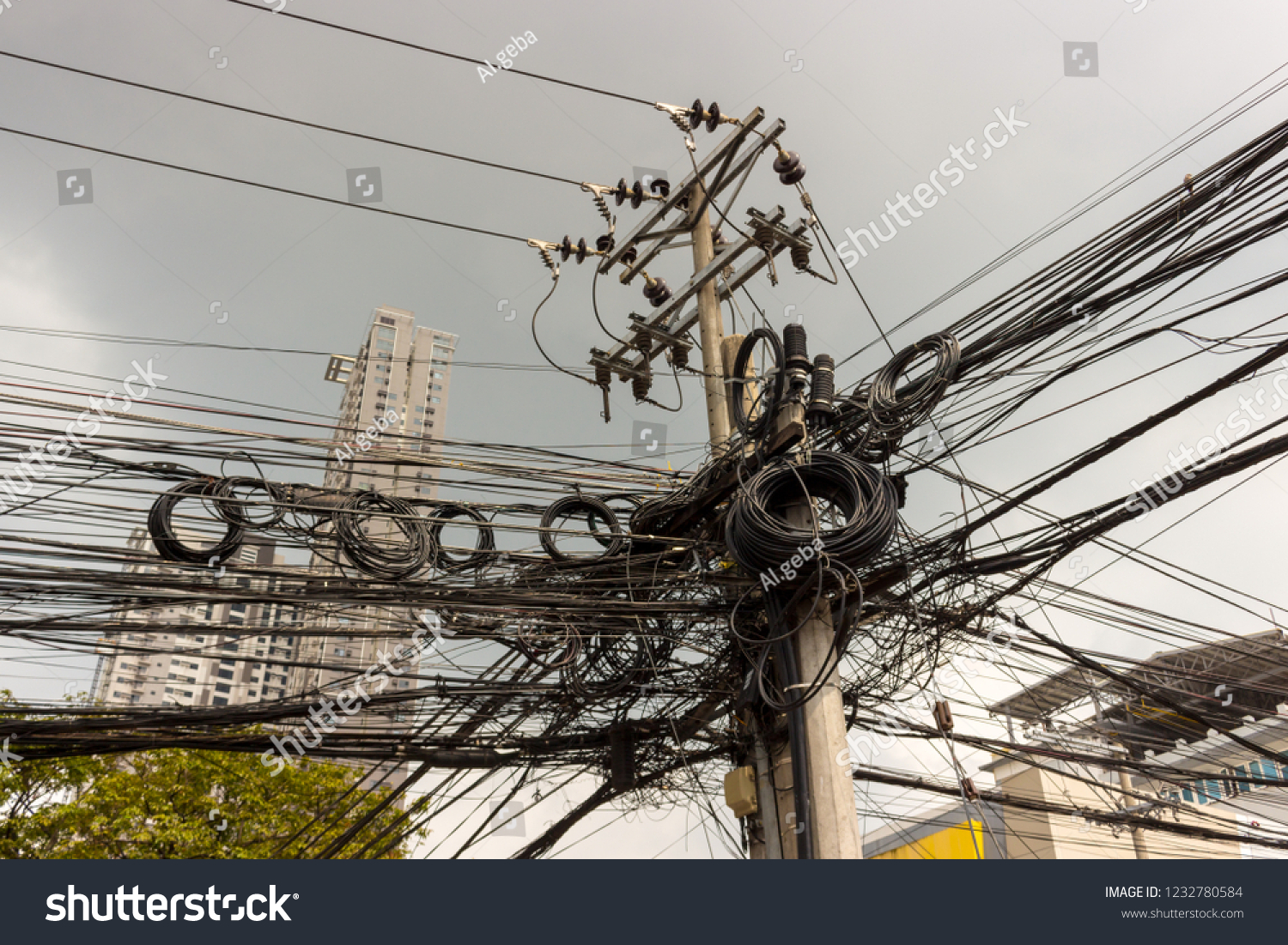 hight resolution of industrial background of messy electrical wires and insulators on the concrete pillar disorderly connection of