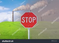 Industrial Smoke Comes Out Of A Chimney Against The Blue ...