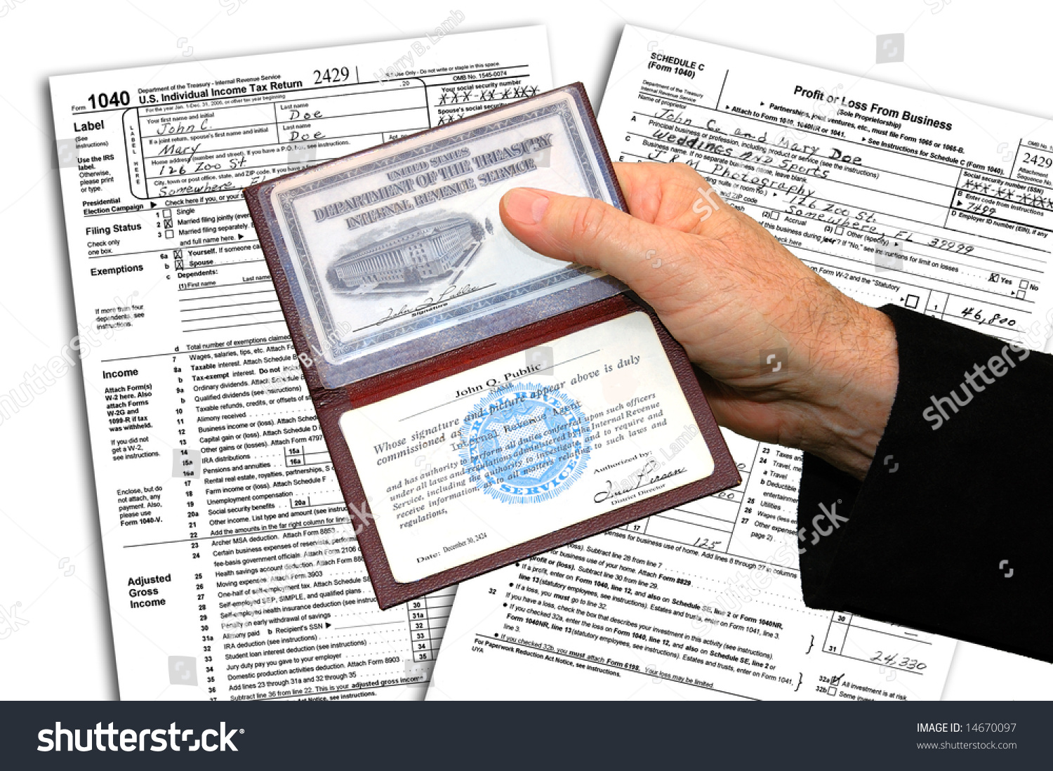 Irs Agent Presenting His Credentials Before Initiating A Federal Income Tax Examination. Stock Photo 14670097 : Shutterstock