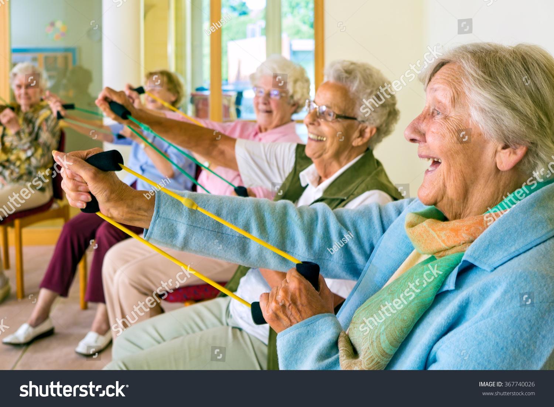 senior citizen chair open back accent large group happy enthusiastic elderly ladies stock photo