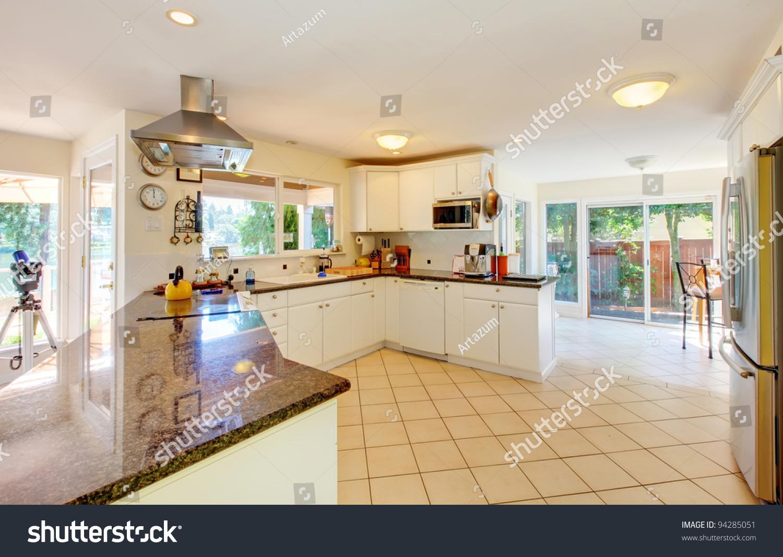 Large Kitchen Beige Floor White Cabinets Stock Photo