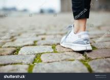Feet Walking On Sidewalk
