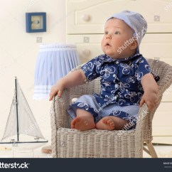 Baby Sitting Chair India Slipper Chairs Under 100 Little Child Boy On The Indoors In