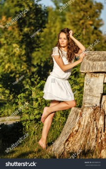 Lovely Girl White Dress Walk Barefoot Stock