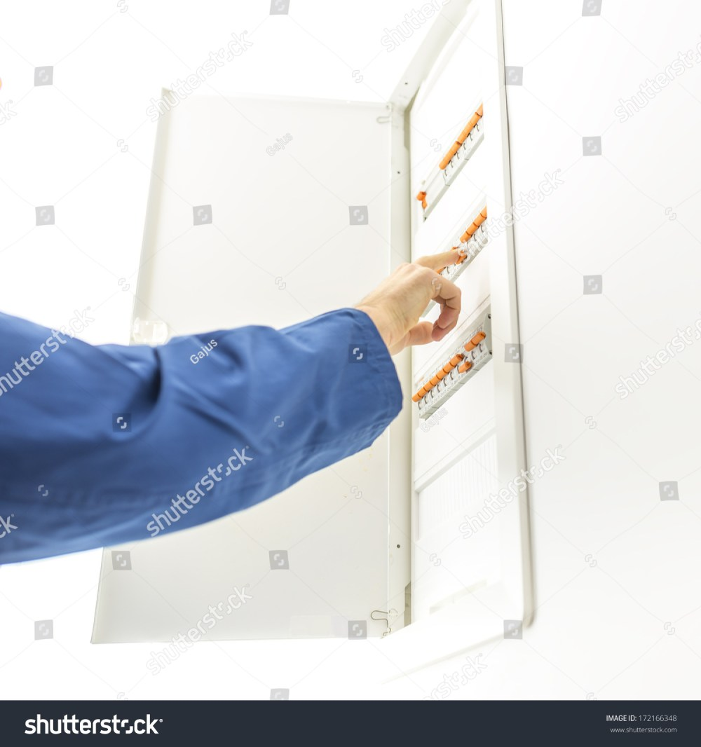 medium resolution of man checking the electrical fuse box at his house to see if any of the circuit