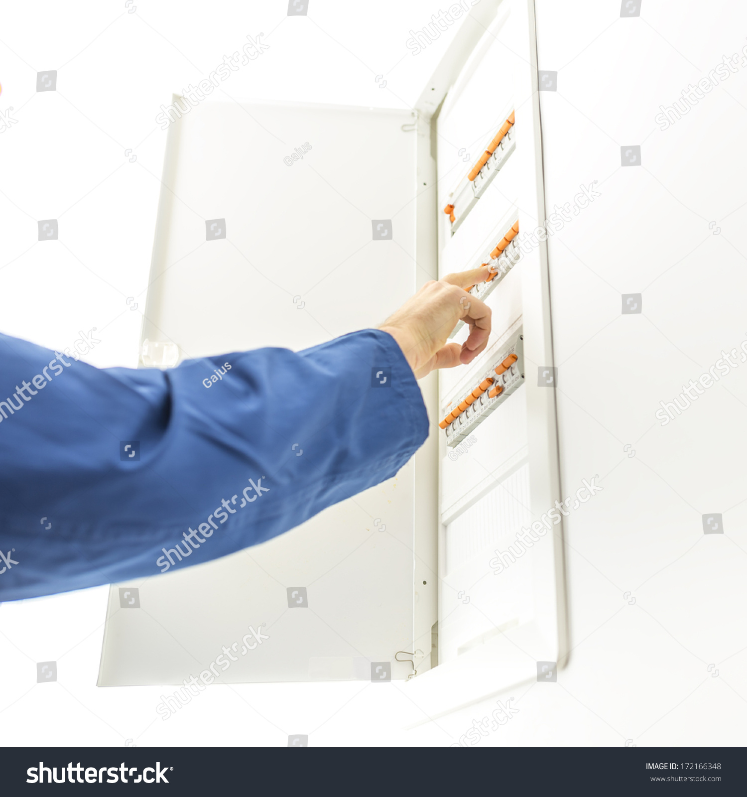 hight resolution of man checking the electrical fuse box at his house to see if any of the circuit