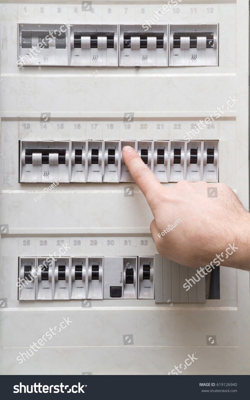 medium resolution of man s finger checking an electricity in the fuse box dangerous activity indoor