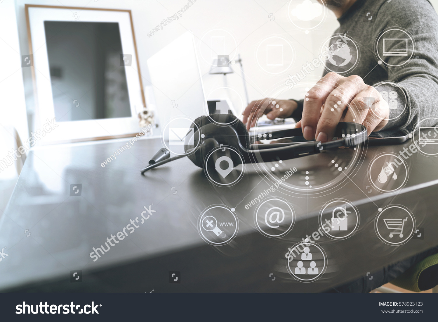 hight resolution of man using voip headset with laptop computer on desk in modern office as call center and