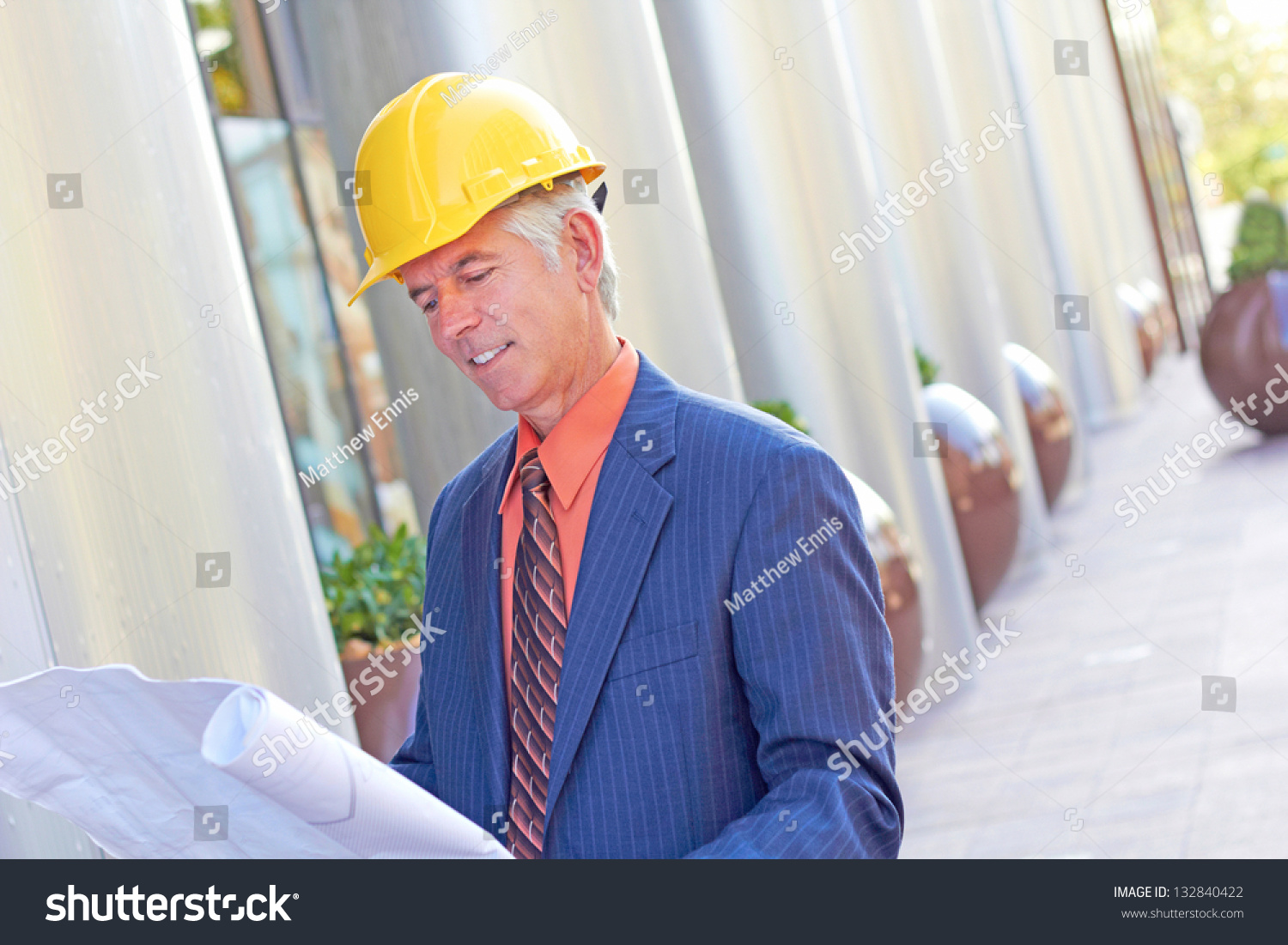 Mature Construction Foreman Looking Up While Holding Blueprint. Horizontal Shot. Stock Photo 132840422 : Shutterstock