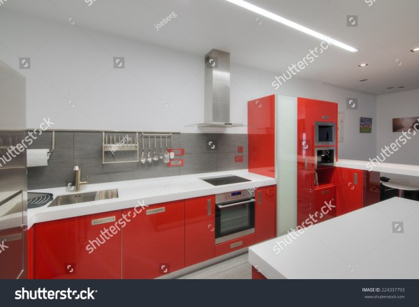 Modern Gloss Red Kitchen With White Seamless Top