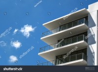 Modern White Building With Balcony On A Blue Sky Stock ...