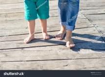 Mother Little Son Walking Barefoot Stock