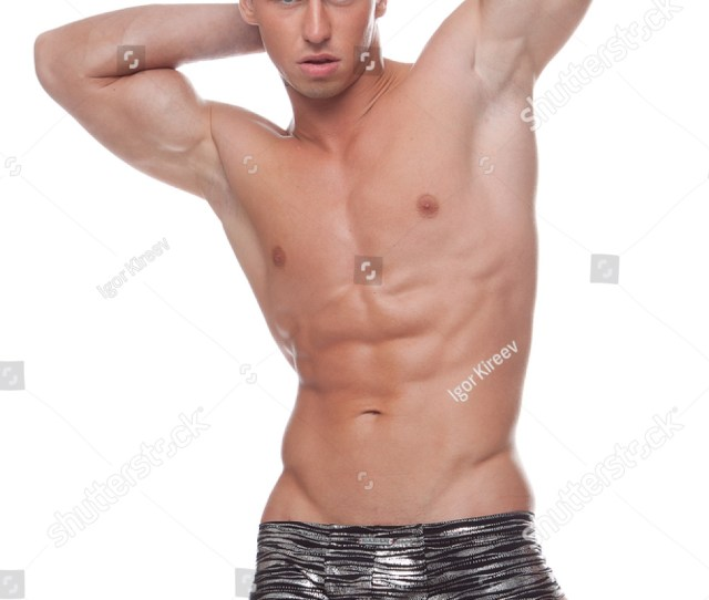 Muscular Sexy Naked Guy In Underwear And Gloves Posing In The Studio