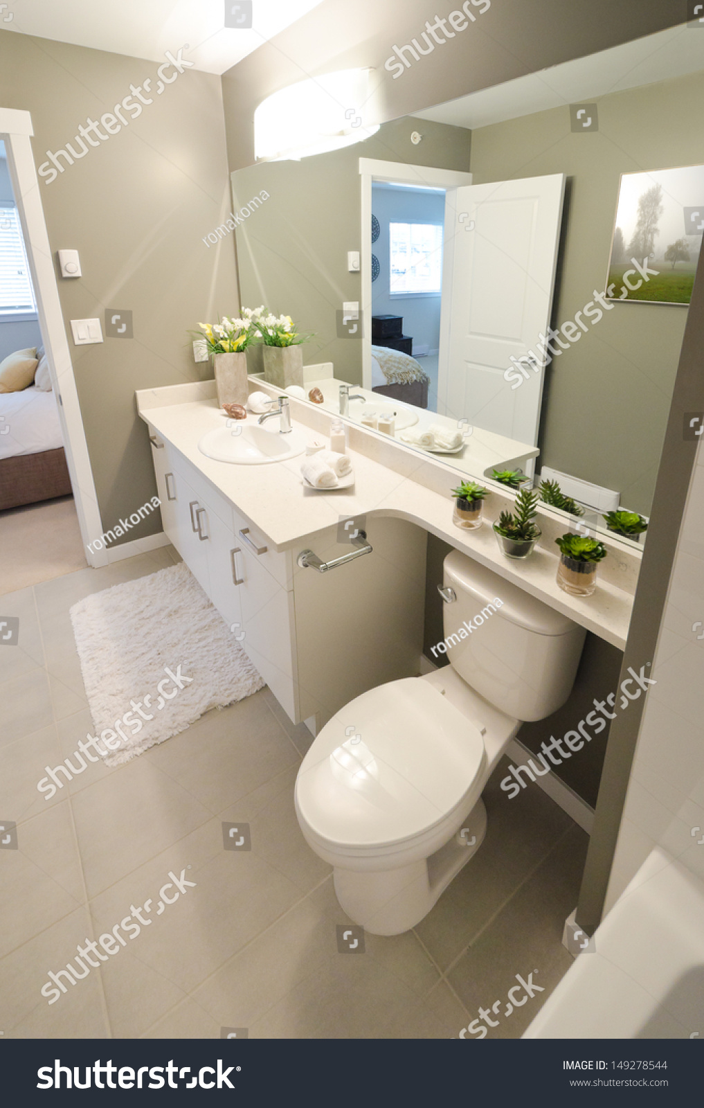 Nicely Decorated Modern Washroom, Bathroom With The Toilet Sit, Sink, Some Plants On The Shelf And Vase With Flowers. Interior Design. Vertical ...