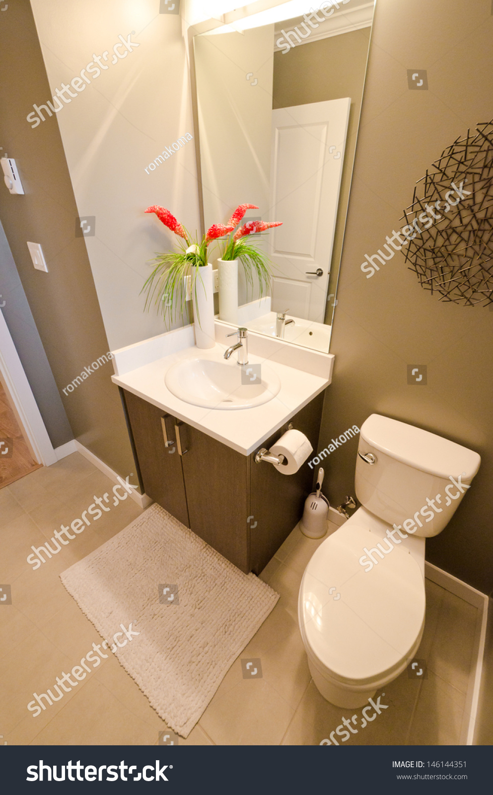 Nicely Decorated Modern Washroom With The Washbasin (Sink), Toilet And Vase With Some Flowers. Interior Design. Vertical. Stock Photo 146144351 ...