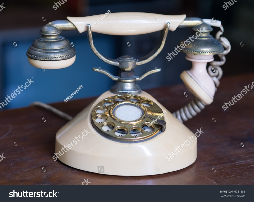 medium resolution of old antique phone on wooden table