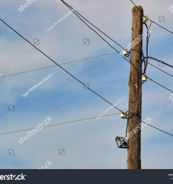 old pole with lamp and wires sky and clouds [ 1500 x 1234 Pixel ]